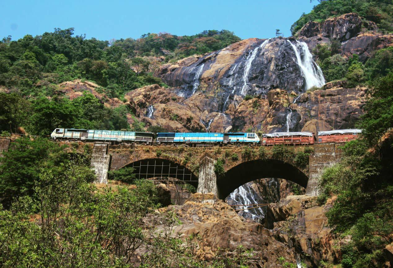 Train passing over Dudhsagar falls